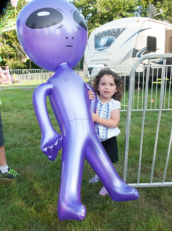 08/24/18 Wesley Bunnell | Staff Emilie Torneo, age 4, holds an inflatable alien on the opening day Friday of the Terryville Fair.