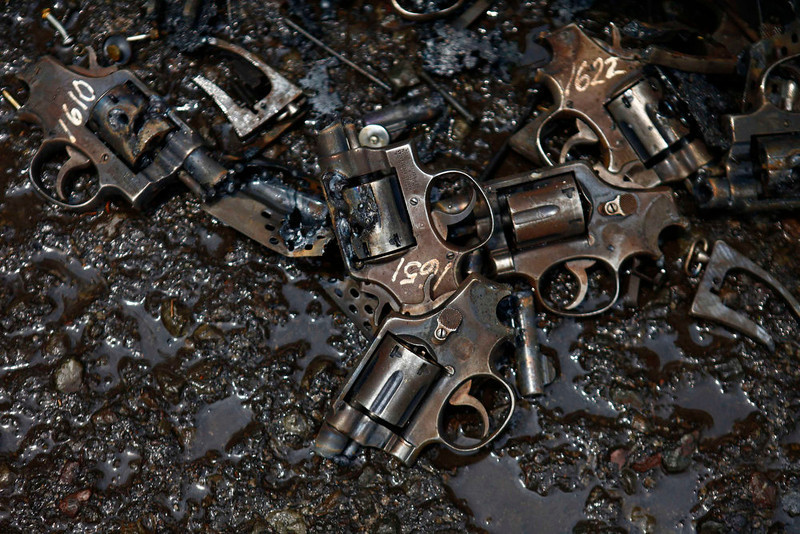 . Parts of confiscated weapons by national security authorities are seen on a floor after they were destroyed at a military zone of Mexico City April 17, 2013. The military is in charge of storing and destroying weapons, not only those handed in by the civilian population sometimes including those inherited from an ancestor who might have fought in the revolution but also the weapons confiscated in the six-year-long, ongoing drug war that has so far killed some 70,000 people. Picture taken April 17, 2013. REUTERS/Edgard Garrido