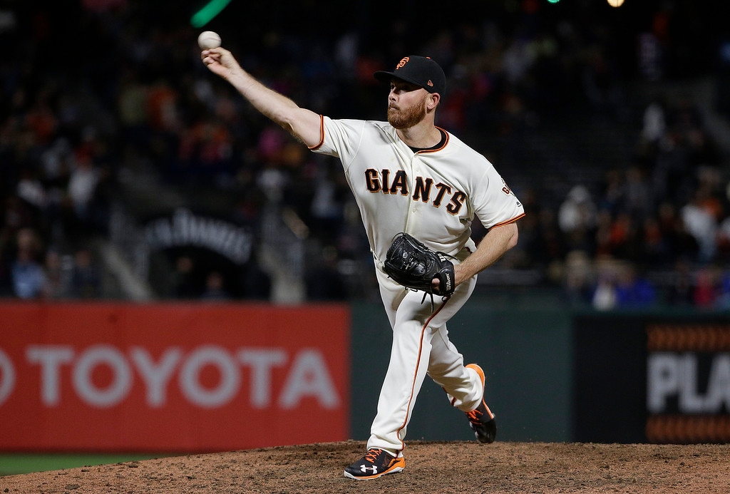 . San Francisco Giants pitcher Sam Dyson throws during the ninth inning of a baseball game against the Cleveland Indians in San Francisco, Tuesday, July 18, 2017. The Giants won 2-1 in ten innings. (AP Photo/Jeff Chiu)