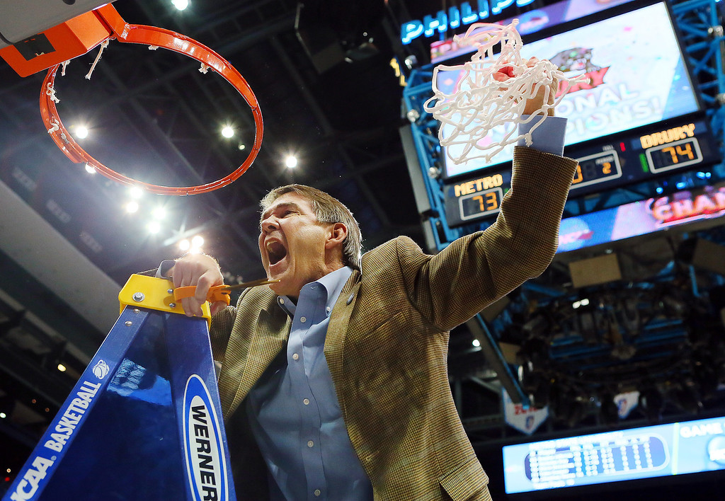 . Drury head coach Steve Hesser celebrates after cutting down the net following their 74-73 win over Metro State in the NCAA Division II national championship college basketball game, Sunday, April 7, 2013, in Atlanta. (AP Photo/Atlanta Journal-Constitution, Curtis Compton)