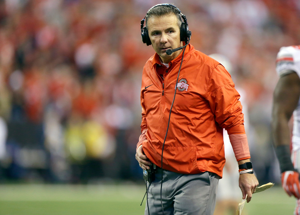 . Ohio State head coach Urban Meyer watches from the sidelines during the second half of the Big Ten championship NCAA college football game against Wisconsin, Saturday, Dec. 2, 2017, in Indianapolis. (AP Photo/Michael Conroy)