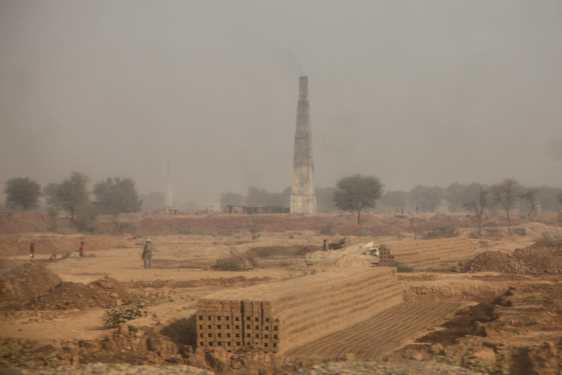 Possibly a brick factory on the route to Agra. The windows were really scratched and dirty.