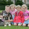 Patrick McClatchey with his sister Shannon and their cousins Alex and Lauren McClatchey along with Prince the dog at the pet show during the Markethill festival. 06W32N13