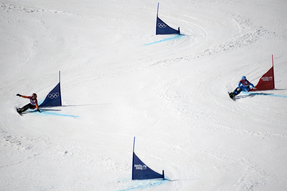 . Netherlands\' Nicolien Sauerbreij (L) and Austria\'s Ina Meschik compete in the Women\'s Snowboard Parallel Giant Slalom 1/8 Finals at the Rosa Khutor Extreme Park during the Sochi Winter Olympics on February 19, 2014. FRANCK FIFE/AFP/Getty Images