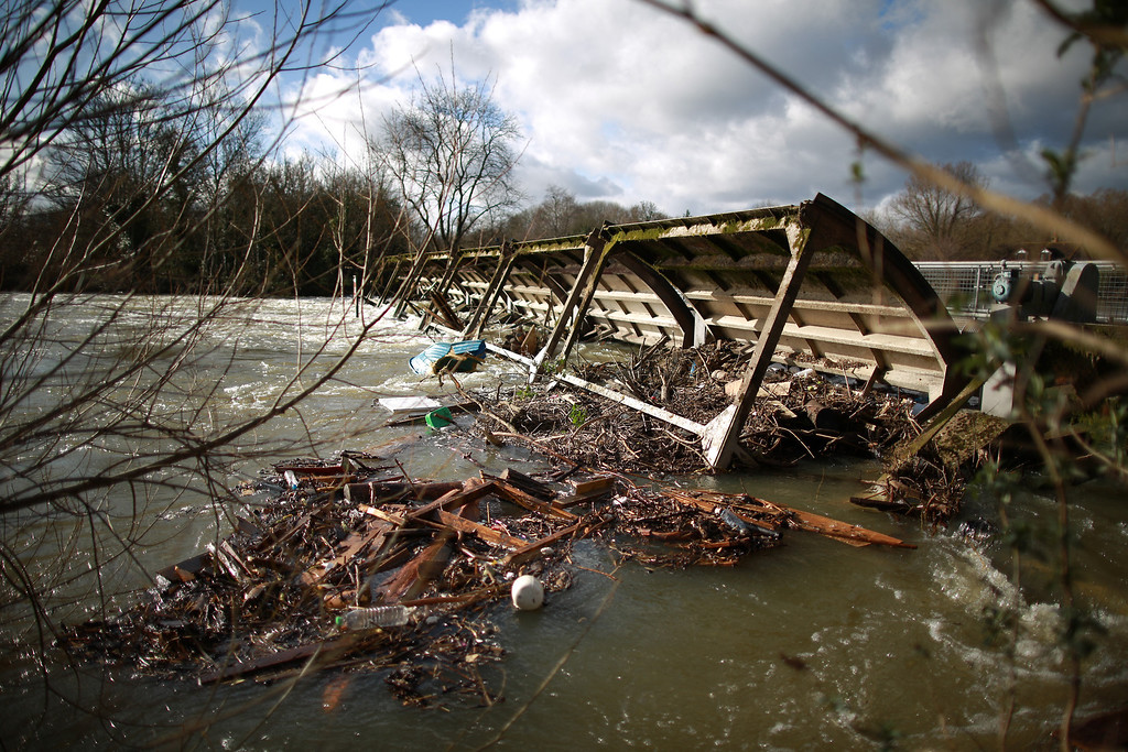 . Penton Hook Weir is surrounded by debris as the river Thames levels remain high on February 13, 2014 in Staines-Upon-Thames, England. Flood water has remained high in some areas and high winds are causing disruption to other parts of the UK with the Met Office issuing a red weather warning.  (Photo by Peter Macdiarmid/Getty Images)
