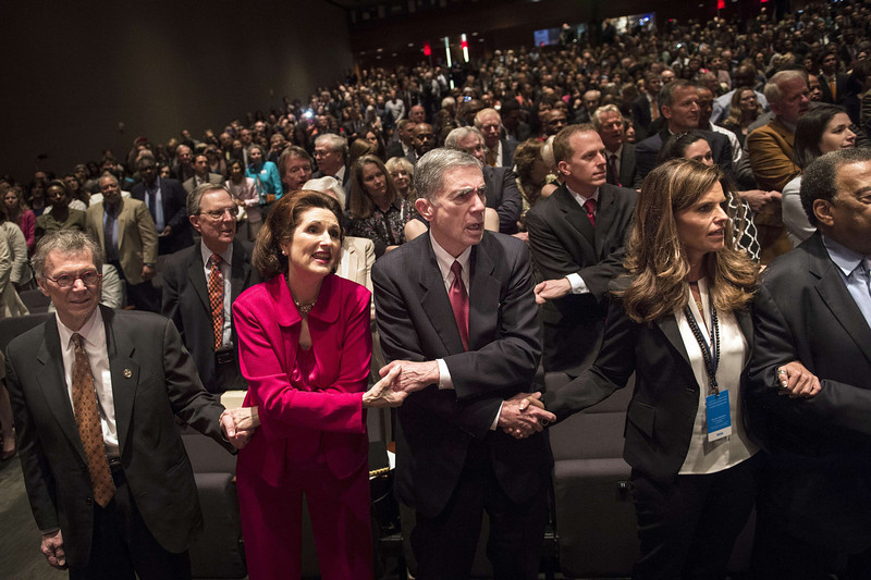 ". From left former US Senator Tom Daschle, Lynda Bird Johnson Robb, Chuck Robb, a former Virginia governor and US Senator, and Maria Shriver join others singing ""We Shall Overcome\"" while waiting for US President Barack Obama to speak at the Lyndon B. Johnson Presidential Library April 10, 2014 in Austin, Texas. Obama is attending a Civil Rights Summit to celebrate the 50th anniversary of the Civil Rights Act of 1964.  (BRENDAN SMIALOWSKI/AFP/Getty Images)"