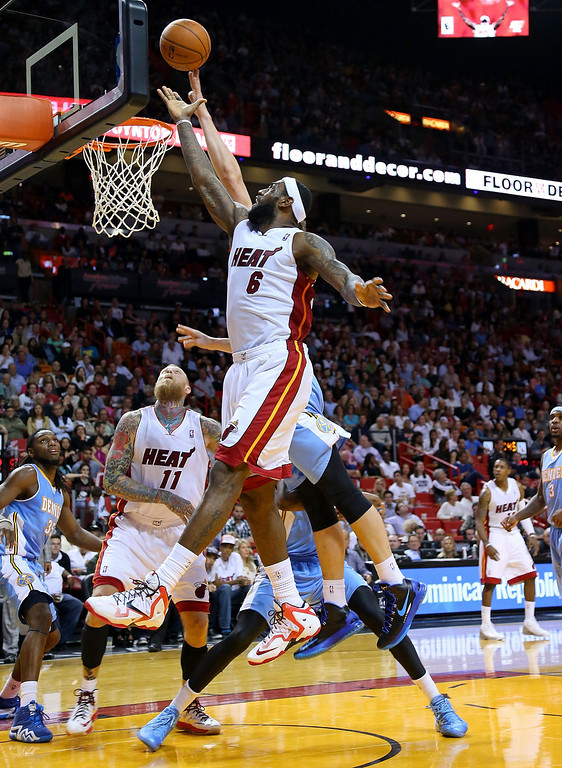 . MIAMI, FL - MARCH 14:  LeBron James #6 of the Miami Heat drives to the basket during a game against the Denver Nuggets at American Airlines Arena on March 14, 2014 in Miami, Florida. (Photo by Mike Ehrmann/Getty Images)
