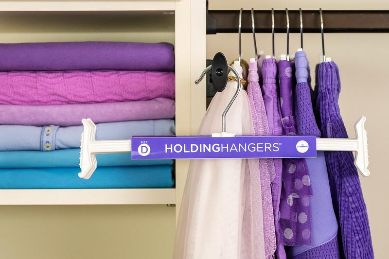 holding hangers purple.jpg
