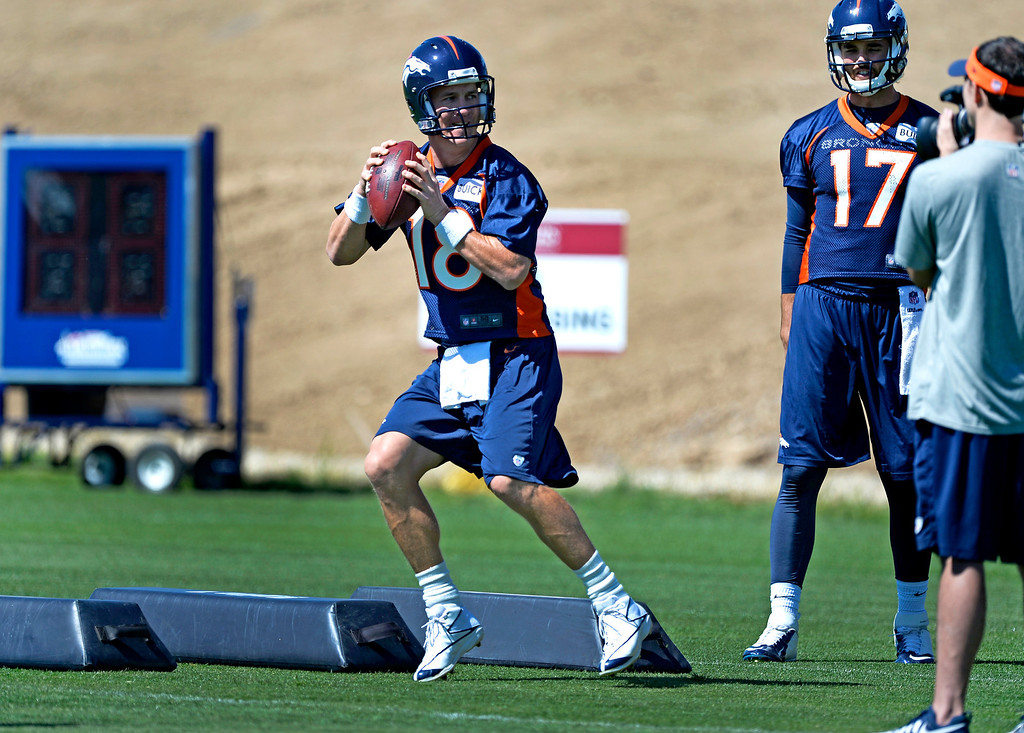 . ENGLEWOOD, CO - JUNE 02: Denver Broncos quarterback Peyton Manning (18) runs through drills during OTAs June 2, 2014 at Dove Valley. (Photo by John Leyba/The Denver Post)