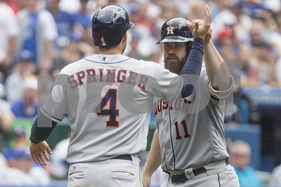 astros-batter-blue-jays-for-60th-win