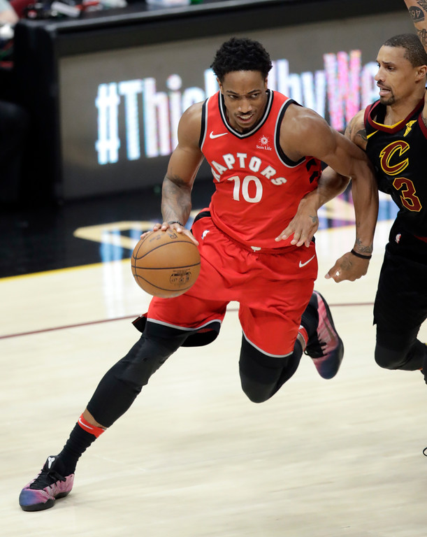 . Toronto Raptors\' DeMar DeRozan (10) drives on Cleveland Cavaliers\' George Hill in the second half of Game 4 of an NBA basketball second-round playoff series, Monday, May 7, 2018, in Cleveland. (AP Photo/Tony Dejak)