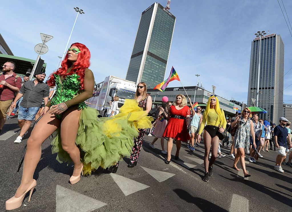. People dressed in drag, take part in the annual gay pride parade in Warsaw, Poland, Saturday, June 9, 2018. The pride celebrations come as LGBT activists say a conservative turn in Poland is only motivating them to fight harder for their rights, even though their hopes of seeing same-sex marriage legalized has no chance now in the country. (AP Photo/Czarek Sokolowski)