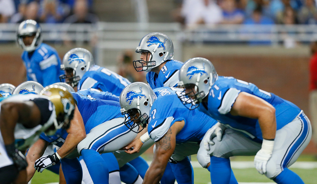 . Detroit Lions quarterback Matthew Stafford (9) lines up at the line of scrimmage against the Jacksonville Jaguars in the first half of a preseason NFL football game at Ford Field in Detroit, Friday, Aug. 22, 2014. (AP Photo/Rick Osentoski)