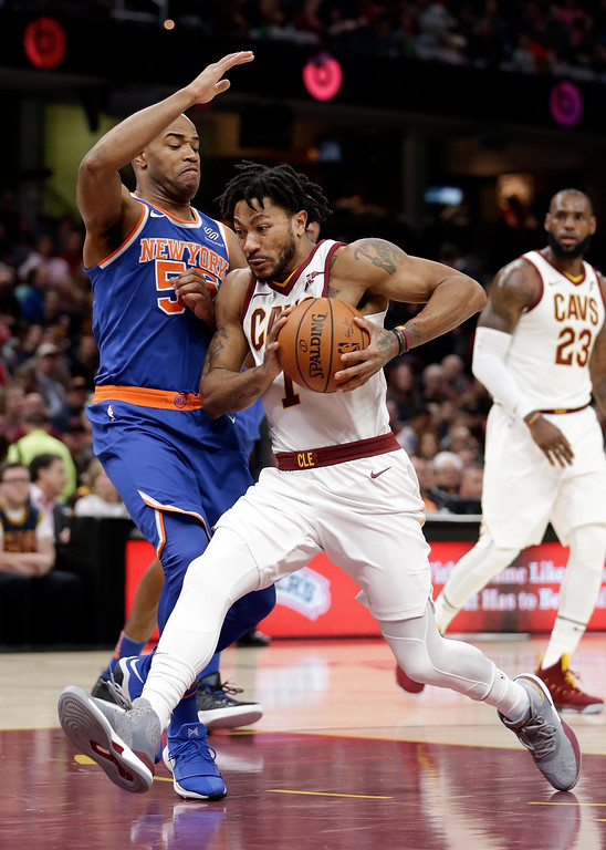 . Cleveland Cavaliers\' Derrick Rose (1) drives to the basket against New York Knicks\' Jarrett Jack (55) in the first half of an NBA basketball game, Sunday, Oct. 29, 2017, in Cleveland. (AP Photo/Tony Dejak)