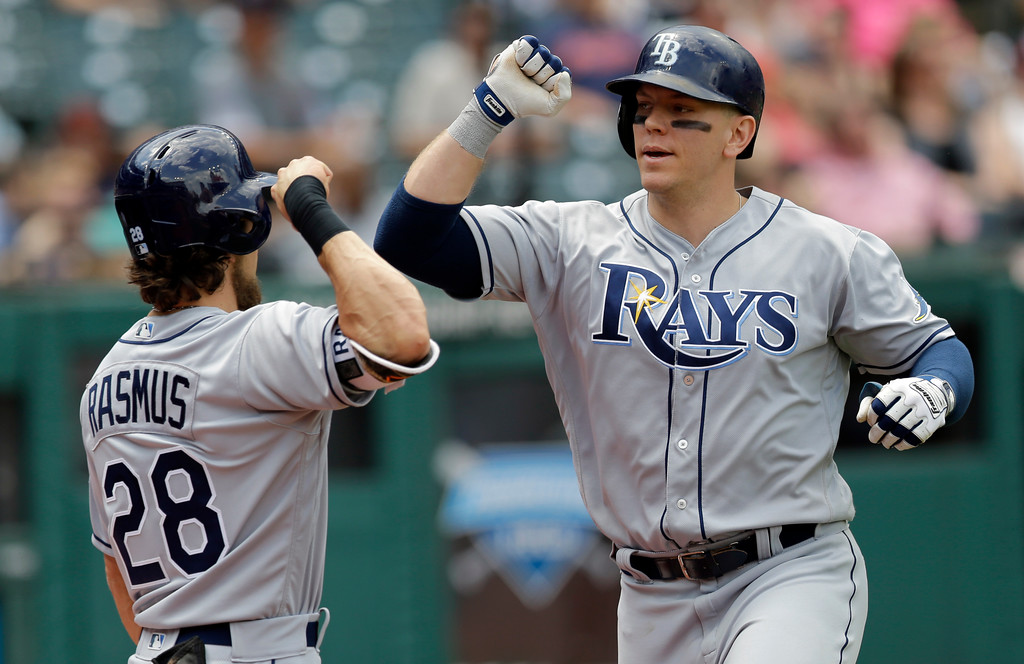 . Tampa Bay Rays\' Logan Morrison, right, is congratulated by Colby Rasmus after Morrison hit a solo home run off Cleveland Indians starting pitcher Josh Tomlin in the third inning of a baseball game, Wednesday, May 17, 2017, in Cleveland. (AP Photo/Tony Dejak)