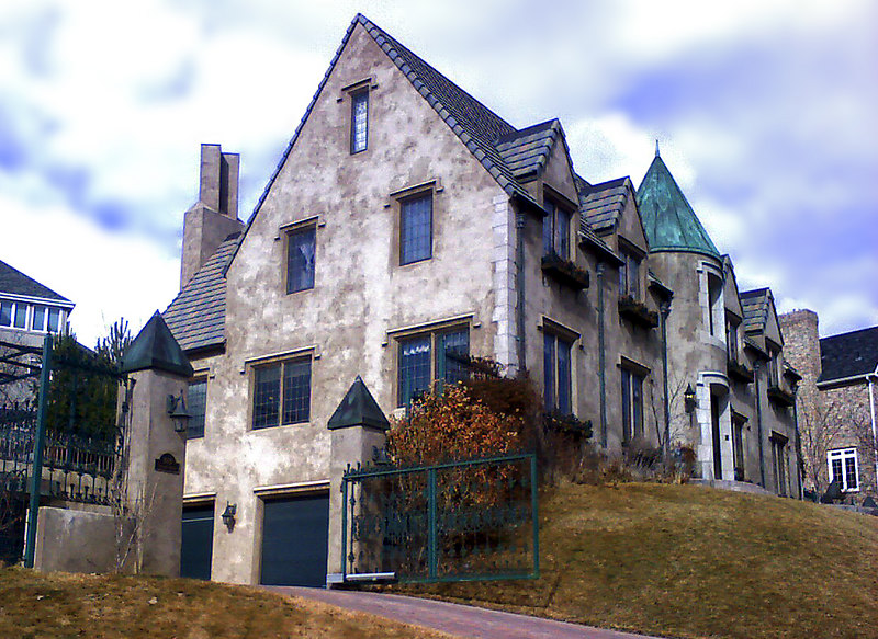 2/22/07 – Even though it looks old, this is a relatively new home in our area. We walk past it regularly. The finish and details are amazing. I didn't have a regular camera with me when I walked past it today and used my cell phone to get this image.