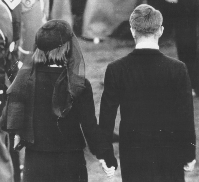 . Jacqueline Kennedy clasps hands with  Robert Kennedy after the burial. Associated Press file