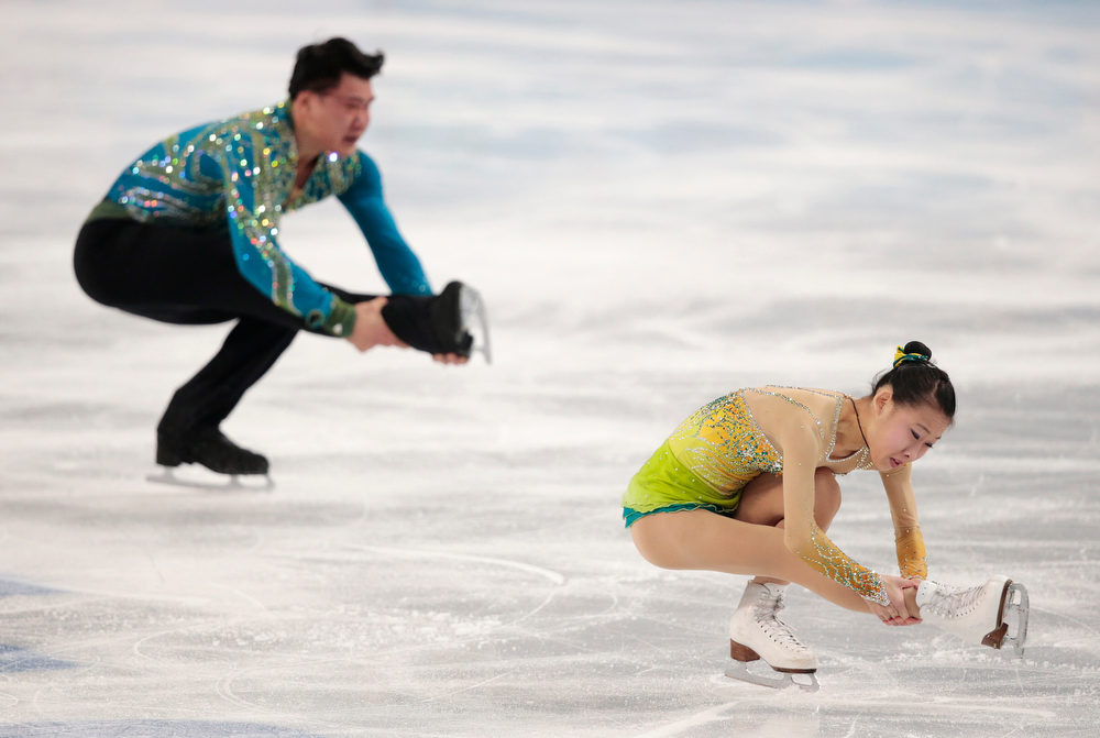 . Peng Cheng and Zhang Hao of China compete in the pairs free skate figure skating competition at the Iceberg Skating Palace during the 2014 Winter Olympics, Wednesday, Feb. 12, 2014, in Sochi, Russia. (AP Photo/Ivan Sekretarev)