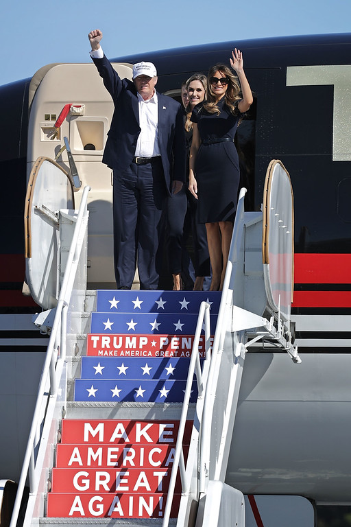 . WILMINGTON, NC - NOVEMBER 05:  Republican presidential nominee Donald Trump (L), his wife Melania Trump and daughter-in-law Lara Yunaska arrive for a campaign rally at Wilmington International Airport November 5, 2016 in Wilmington, North Carolina. With less than a week before Election Day in the United States, Trump and his opponent, Democratic presidential nominee Hillary Clinton, are campaigning in key battleground states that each must win to take the White House.  (Photo by Chip Somodevilla/Getty Images)