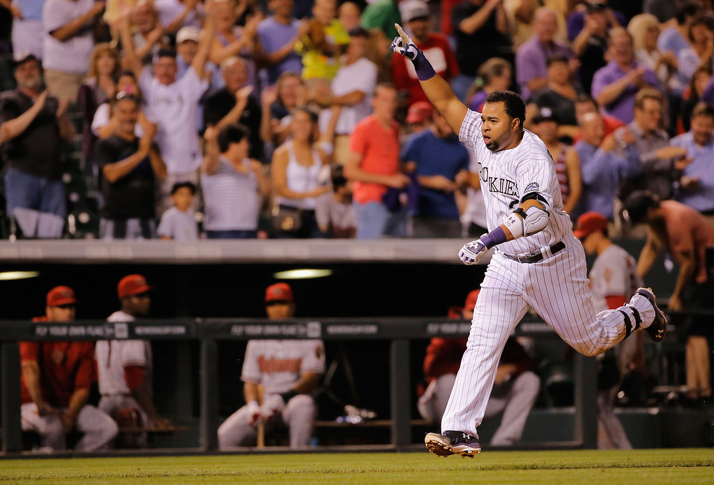 . DENVER, CO - SEPTEMBER 18:  Wilin Rosario #20 of the Colorado Rockies celebrates as he comes home to score on his game winning walk off two run home run off of Addison Reed #43 of the Arizona Diamondbacks at Coors Field on September 18, 2014 in Denver, Colorado. The Rockies defeated the Diamondbacks 7-6.  (Photo by Doug Pensinger/Getty Images)