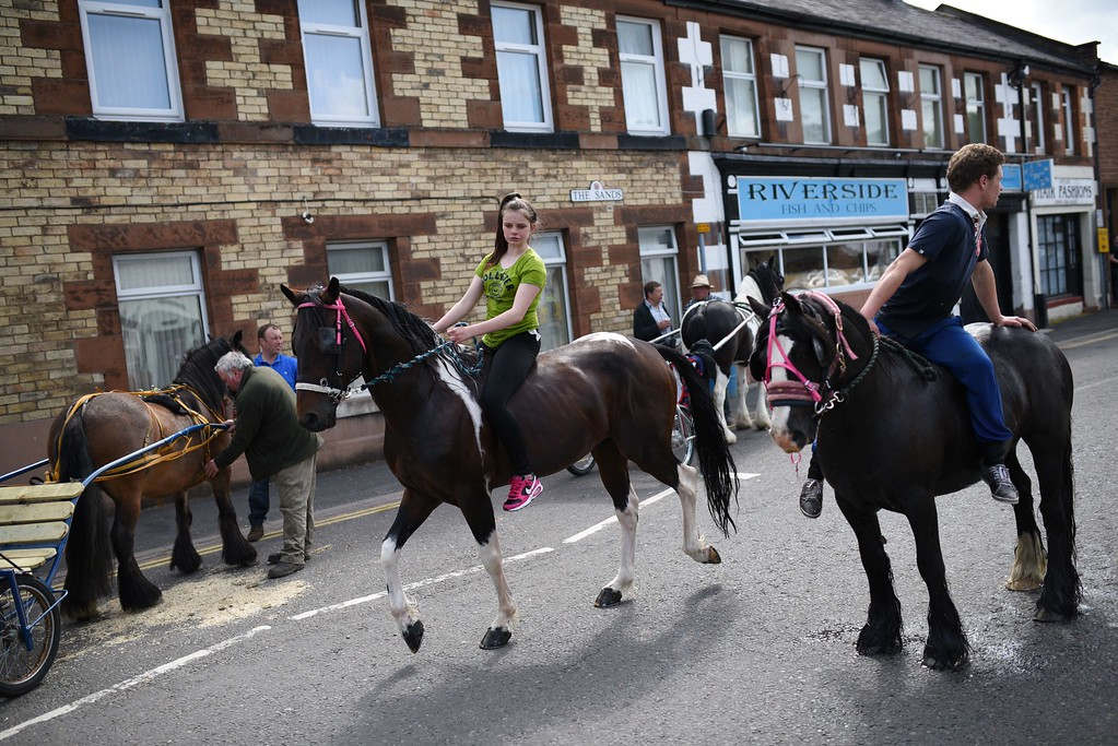 . People prepare to wash horses in the River Eden on the opening day of the annual Appleby Horse Fair, in the town of Appleby-in-Westmorland, North West England on June 4, 2015. The annual event attracts thousands of travelers from across Britain to gather and buy and sell horses. AFP PHOTO / OLI SCARFF/AFP/Getty Images