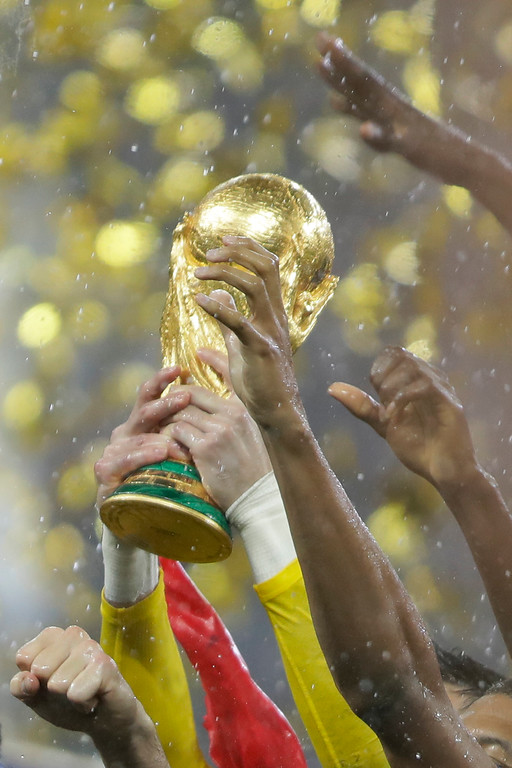 . French players raise the trophy after the final match between France and Croatia at the 2018 soccer World Cup in the Luzhniki Stadium in Moscow, Russia, Sunday, July 15, 2018. (AP Photo/Natacha Pisarenko)