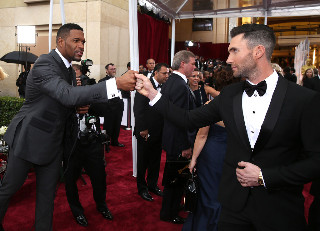 . Michael Strahan, left, and Adam Levine greet eachother at the Oscars on Sunday, Feb. 22, 2015, at the Dolby Theatre in Los Angeles. (Photo by Matt Sayles/Invision/AP)