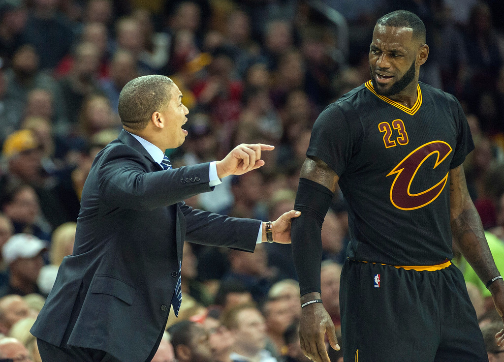. Cleveland Cavaliers head coach Tyronn Lue talks with LeBron James during the second half of an NBA basketball game against the Atlanta Hawks in Cleveland, Tuesday, Nov. 8, 2016. The Hawks won 110-106. (AP Photo/Phil Long)