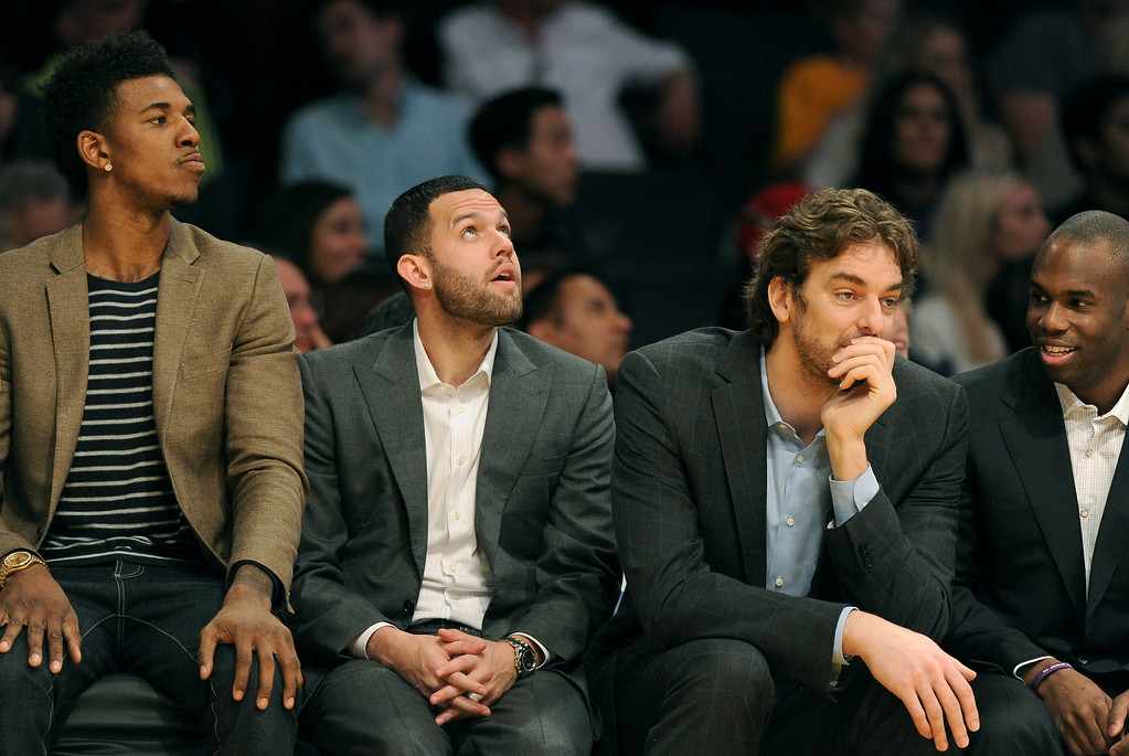 . The Los Angeles Lakers\' bench watch the Chicago Bulls defeat them in a NBA basketball game at Staples Center in Los Angeles, CA. on Sunday, February 9, 2014. (Photo by Sean Hiller/ Daily Breeze).