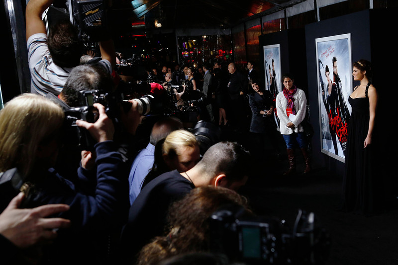 ". Actress Gemma Arterton is photographed by the media as she arrives at the premiere of the film ""Hansel and Gretel: Witch Hunters\"" at Grauman\'s Chinese Theatre in Hollywood, California January 24, 2013. REUTERS/Patrick Fallon"