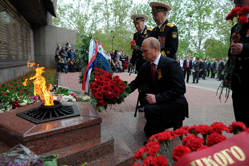 . Russian President Vladimir Putin with WWII veterans, lays flowers at a monument to heroic defenders of Sevastopol during the Victory Day celebration in Sevastopol, Crimea, Friday, May 9, 2014.  (AP Photo/RIA-Novosti, Alexei Druzhinin, Presidential Press Service)