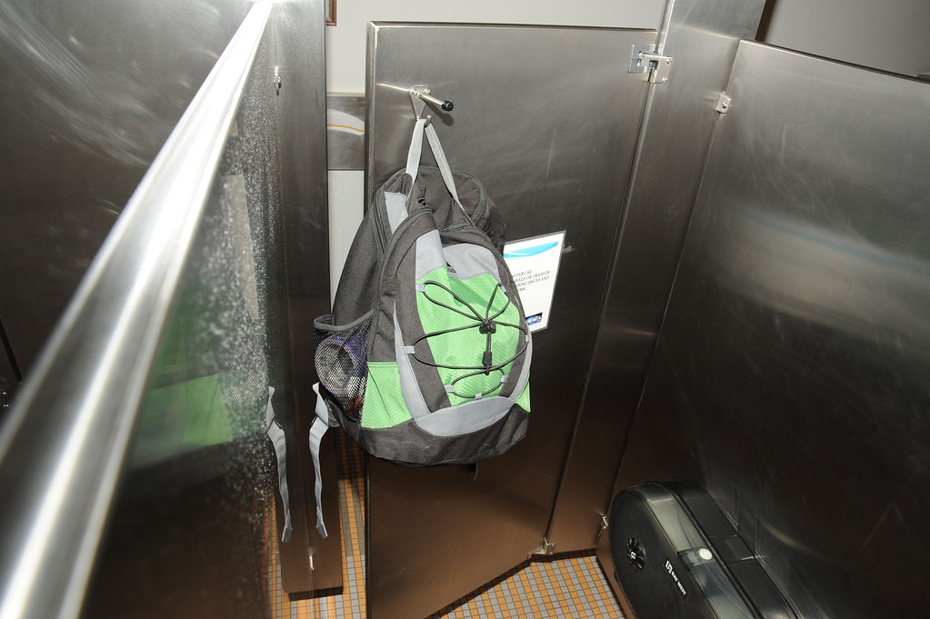 . In this handout frame grab from the Washington Navy Yard provided by the FBI on September 25, 2013, Aaron Alexis backpack is found in the fourth-floor mens bathroom, hanging on the back of a stall door September 16, 2013 in Washington, DC.  (Photo by FBI via Getty Images)