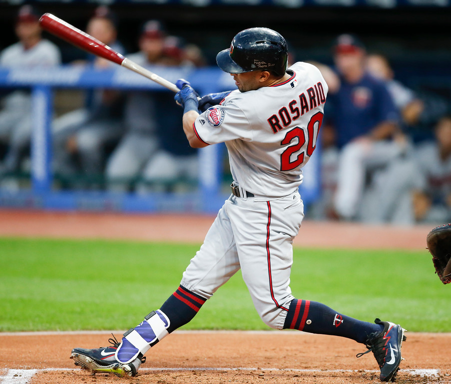 . Minnesota Twins\' Eddie Rosario hits a solo home run off Cleveland Indians starting pitcher Josh Tomlin during the first inning in a baseball game, Tuesday, Sept. 26, 2017, in Cleveland. (AP Photo/Ron Schwane)