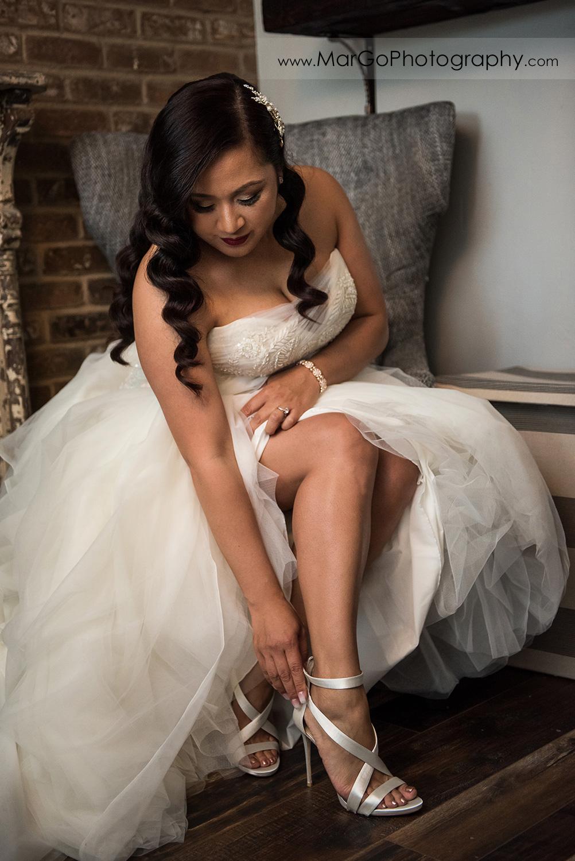 bride putting on wedding shoes at Sunol's Casa Bella