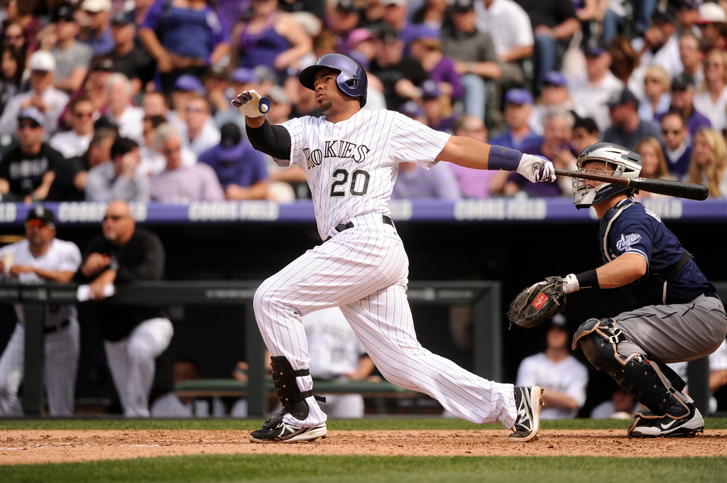 . Wilin Rosario (20) of the Colorado Rockies hits a home run in the fourth inning. (Photo by Karl Gehring/The Denver Post)