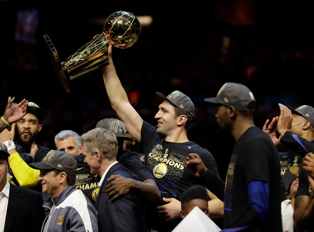 . Golden State Warriors\' Zaza Pachulia celebrates after the Warriors defeated the Cleveland Cavaliers 108-85 in Game 4 of basketball\'s NBA Finals to win the NBA championship, Friday, June 8, 2018, in Cleveland. (AP Photo/Tony Dejak)