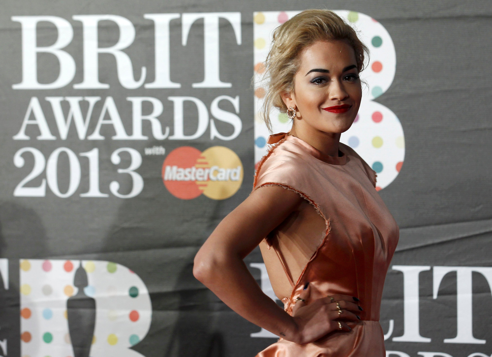 Description of . British singer Rita Ora arrives for the BRIT Awards, celebrating British pop music, at the O2 Arena in London February 20, 2013. REUTERS/Luke Macgregor