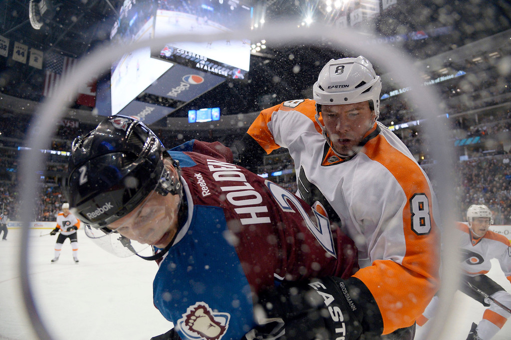 . Colorado Avalanche defenseman Nick Holden (2) battles with Philadelphia Flyers defenseman Nicklas Grossmann (8) for the puck along the boards during the first period January 2, 2014 at Pepsi Center. (Photo by John Leyba/The Denver Post)