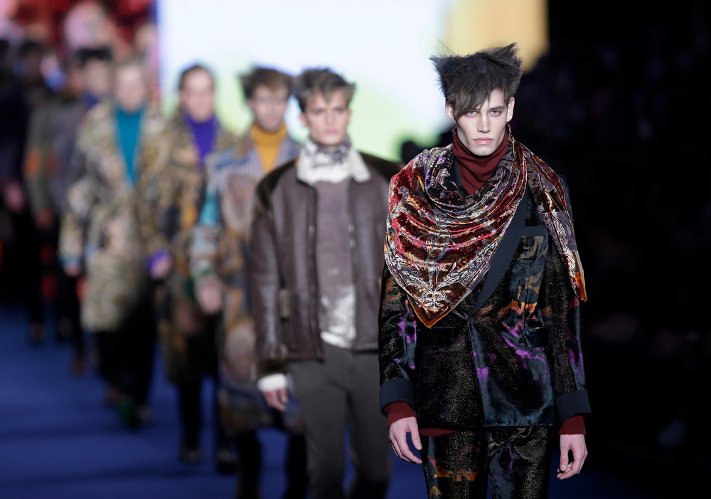 Description of . Models wear creations for Etro men's Fall-Winter 2013-14 collection, part of the Milan Fashion Week, unveiled in Milan, Italy, Monday, Jan. 14, 2013. (AP Photo/Antonio Calanni)