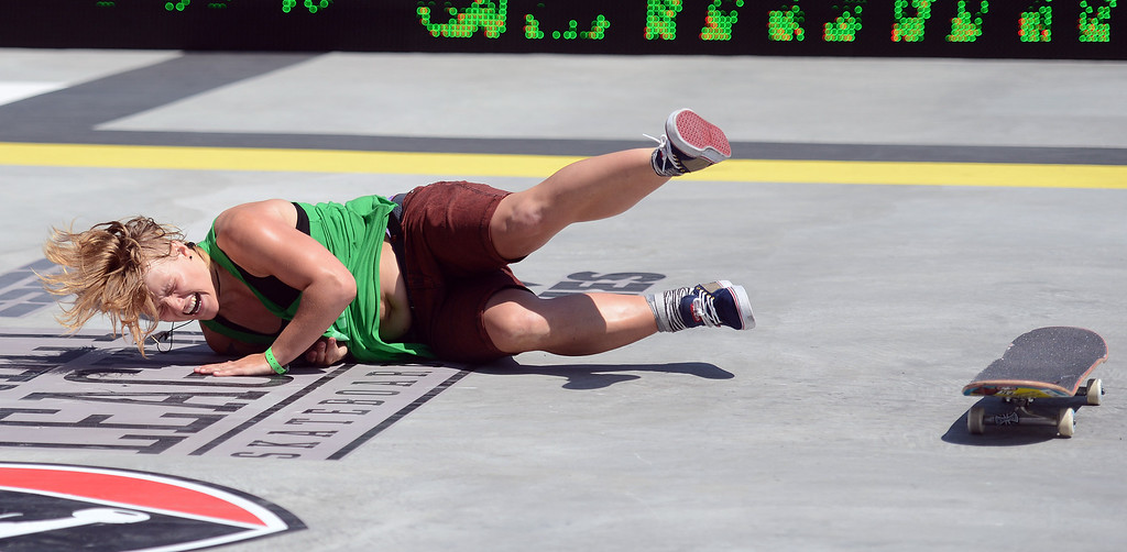 . Candy Jacobs takes a fall during the  X Games Los Angeles Women\'s Skateboard Street Final at LA Live Thursday, August 1, 2013. (Hans Gutknecht/Los Angeles Daily News)