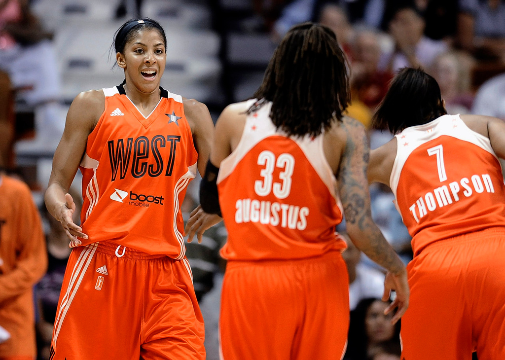 . West\'s Candace Parker, left, of the Los Angeles Sparks, celebrates with Semone Augustus, center, of the Minnesota Lynx, and Tina Thompson, of the Seattle Storm. (AP Photo/Jessica Hill)