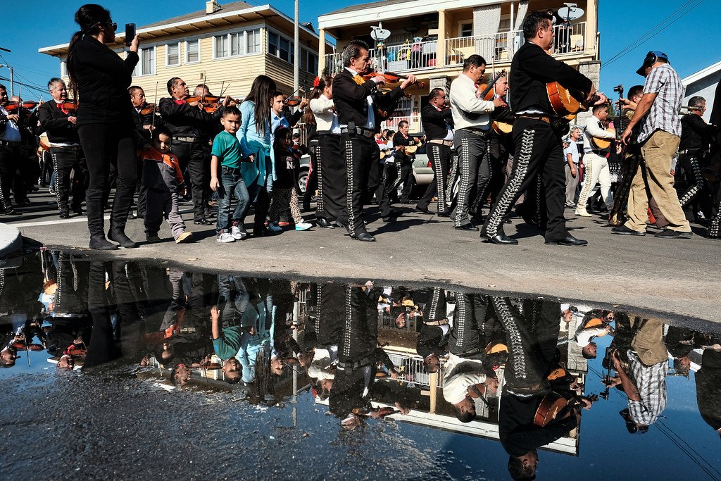 . Mariachis play in the street during the Santa Cecilia festival and procession in the Boyle Heights section of Los Angeles on Tuesday, Nov. 22, 2016. Musicians from around the country gathered for Mariachi Sol de Mexico to celebrate Santa Cecilia. The festival honors Santa Cecilia the patron saint of musicians. (AP Photo/Richard Vogel)