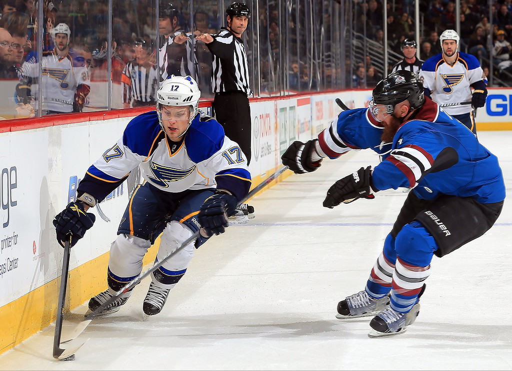 . Vladimir Sobotka #17 of the St. Louis Blues controls the puck while under pressure from Greg Zanon #4 of the Colorado Avalanche at the Pepsi Center on February 20, 2013 in Denver, Colorado.  (Photo by Doug Pensinger/Getty Images)
