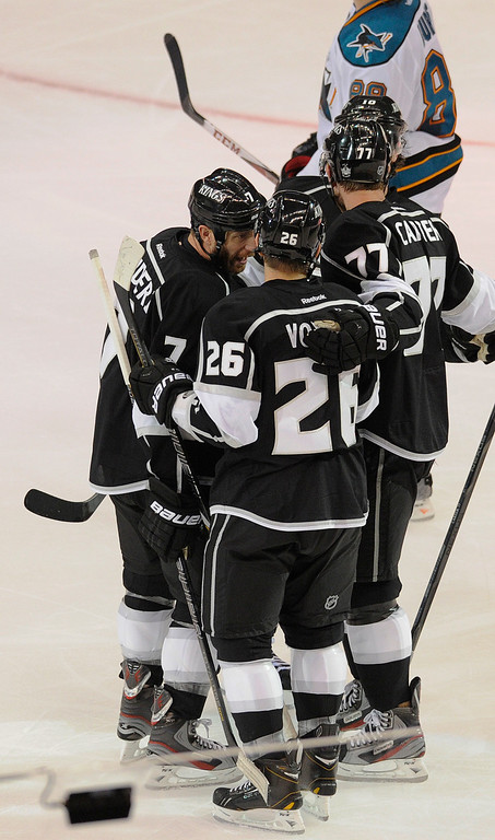 . Kings#26 Slava Voynov is congratulated on his second goal of the evening during the second period. The Kings played the San Jose Sharks during the first game in the Second Round of the Western Conference Playoffs. Los Angeles CA 5/14/2013(John McCoy/LA Daily News)