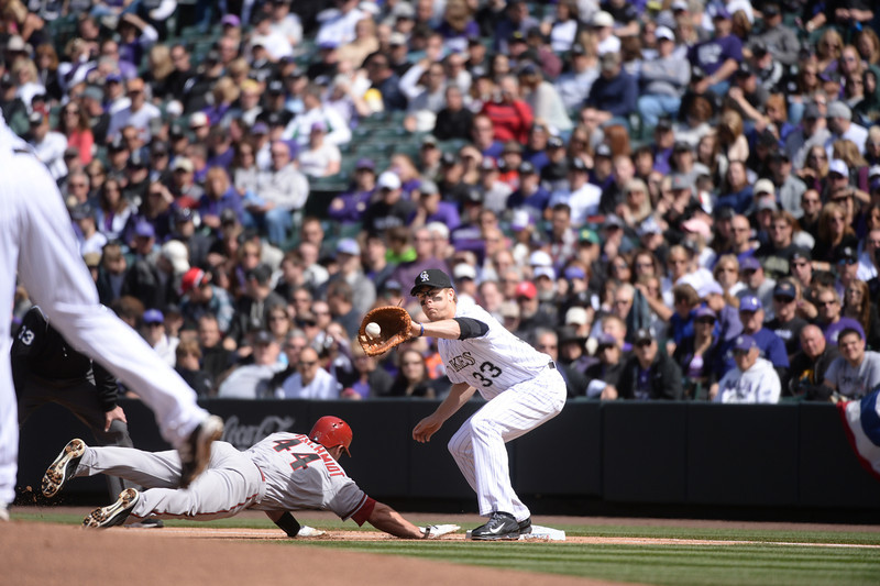 . Diamondbacks\' Paul Goldschmidt avoids being picked off by Rockies first baseman Justin Morneau during the first inning. The Colorado Rockies hosted the Arizona Diamondbacks in the Rockies season home opener at Coors Field in Denver, Colorado Friday, April 4, 2014. (Photo by Karl Gehring/The Denver Post)