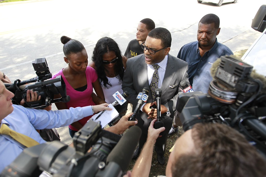 . Family members of a student victim with Pastor E.A. Deckard, center, answer questions about the victim involved in the Spring, Texas High School stabbing that left a 17-year-old dead and three others injured, Wednesday, Sept. 4, 2013 in Spring, Texas. (AP Photo/Houston Chronicle, Cody Duty)