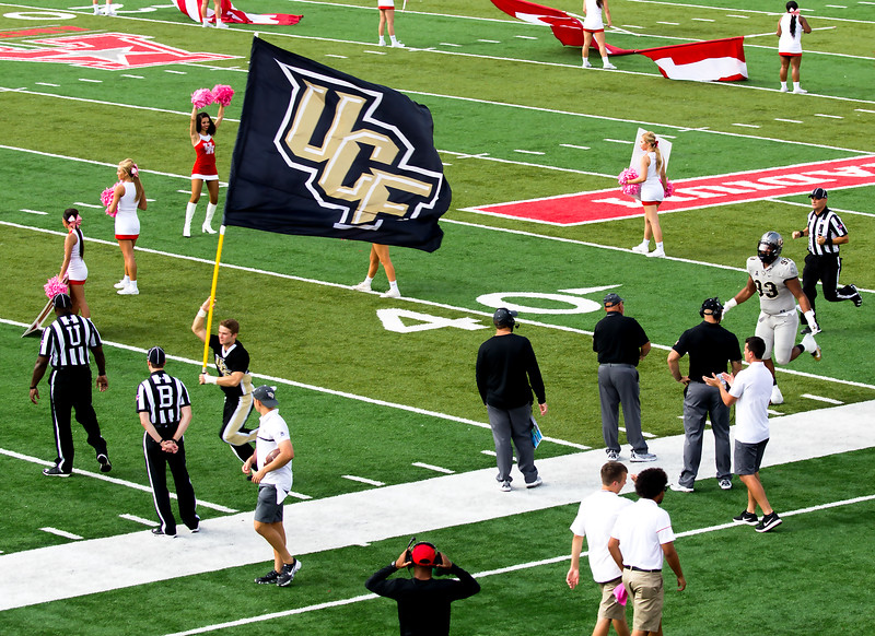 The Black Flag of UCF is followed by our oponents.
