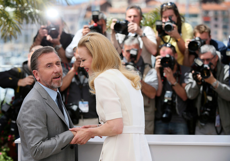 . Actress Nicole Kidman, right, and actor Tim Roth, left, pose for photographers during a photo call for Grace of Monaco at the 67th international film festival, Cannes, southern France, Wednesday, May 14, 2014. (AP Photo/Alastair Grant)