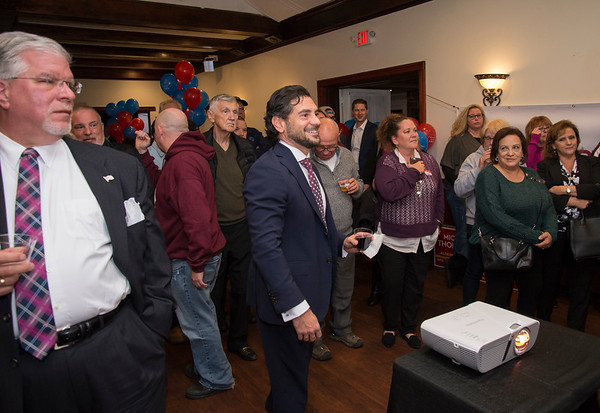 11/05/19 Wesley Bunnell | StaffrrCandidates for public office running under the Team Stewart ticket gathered at the Back Nine Tavern at Stanley Golf Course on Tuesday evening to celebrate Stewart's victory and the Republicans taking back a majority of seats on the city council. State Senator Gennarro Bizarro smiles as he watches the results.