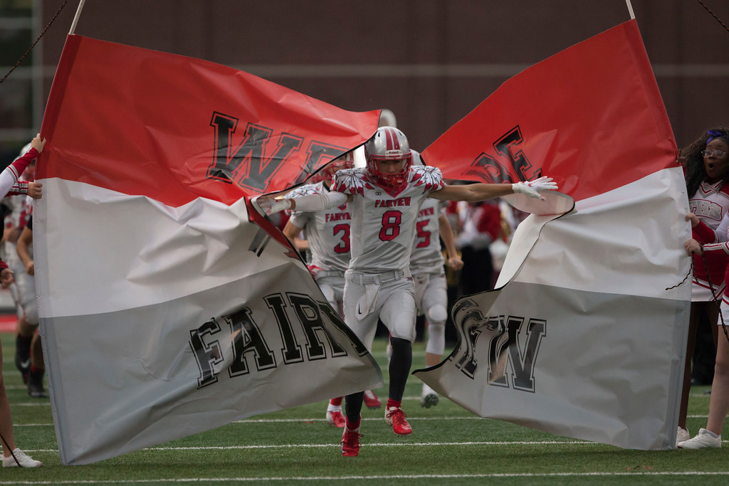 . Jen Forbus - The Morning Journal<br> Fairview\'s Turner Hahn leads his team onto the field against Bay on Sept. 7.